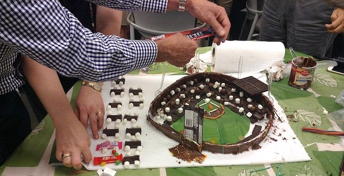 Team putting together a chocolate stadium