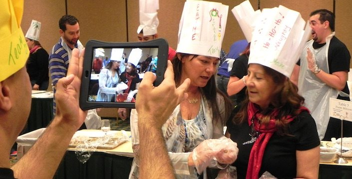 Participant taking iPad photo during cooking challenge