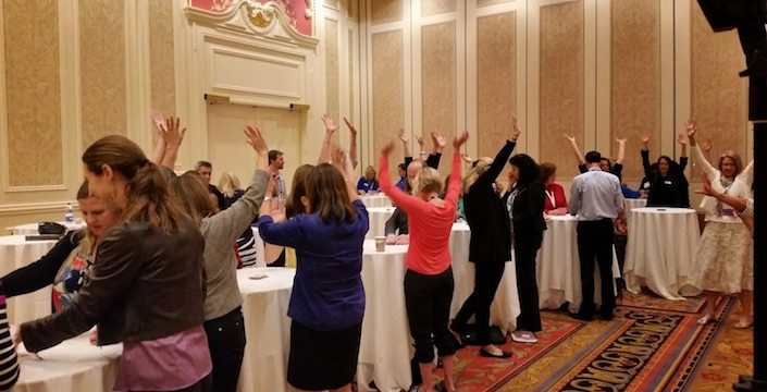 Igniting Team Performance Hands Up