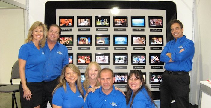 Best Corporate Events team in front of giant iPad