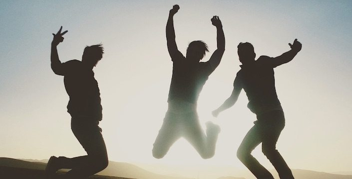 Three men jumping in the air
