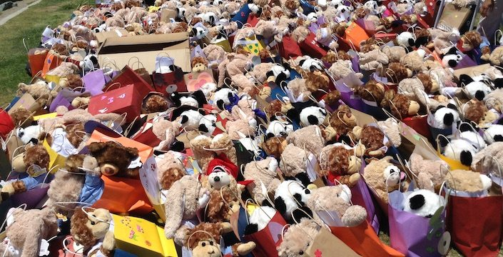 Picture of hundreds of bears and blanket completed gift bags