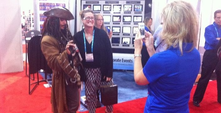 Woman getting her photo taken with Captain Jack Sparrow lookalike