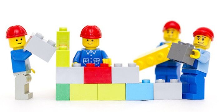 Lego men with lego blocks