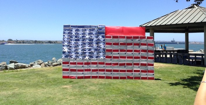 Outdoor photo of Operation Military Care donation boxes in the shape of a flag