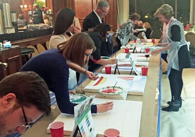 participants working on individual paintings