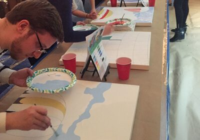 participant working on a painting