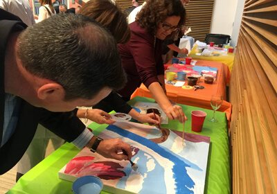 Participants working on their paintings