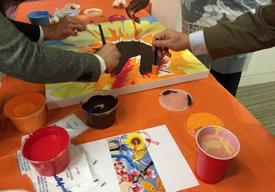 Participants working on their painting