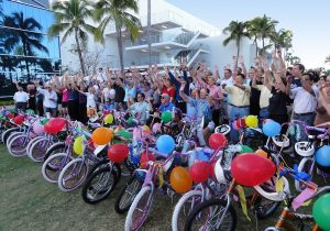 Large group outside cheering with their completed and decorated bikes
