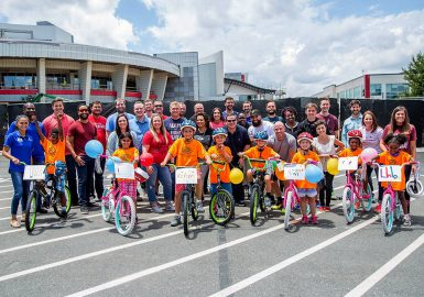 Team with their completed Boys and Girls Club Bike Donation and the children that received them