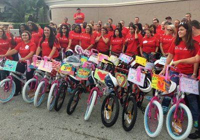 Teams posing with their completed bikes
