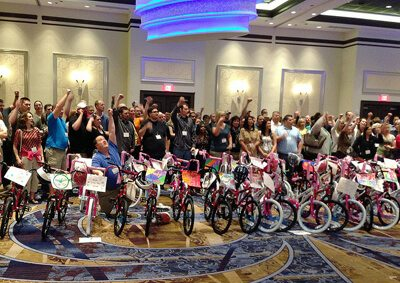 Participants pose with completed bike build.