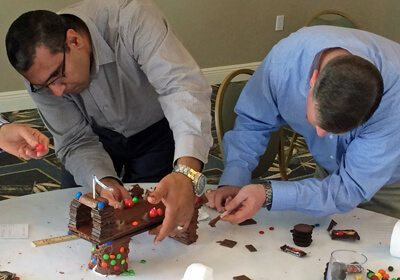 Picture of duo in the middle of constructing their chocolate building