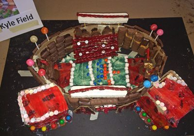 Picture of a chocolate football stadium with candy ornaments