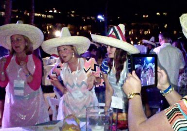 Team singing a jingle while wearing sombreros