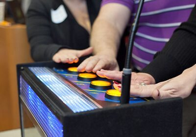 Picture of Game Show Mania buzzers with hands about to press the buttons