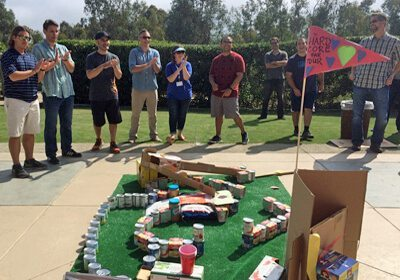 Team applauding their finished mini-golf course