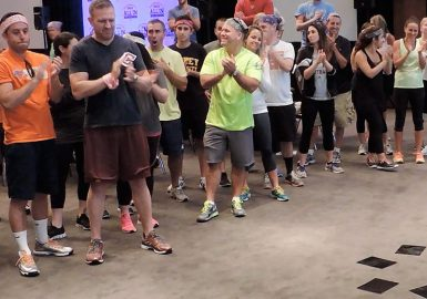 Picture of participants applauding during a Igniting Team Performance program