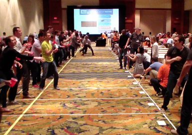 Participants doing a Ball Toss competition in a hotel ballroom
