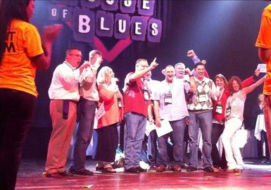 Winning team poses on House of Blues stage