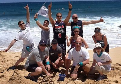 Picture of winners posing at the beach after a Let the Games Begin program