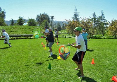 Picture of teams catching frisbees during a Let the Games Begin program