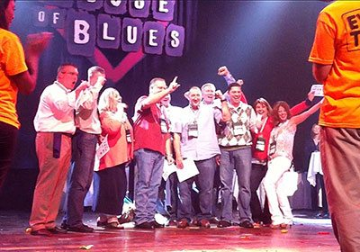 A Minute 2 Win It team posing together on House of Blues stage