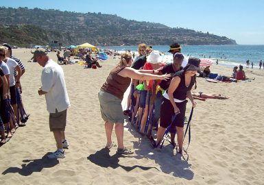 Group doing the Ski Team Challenge on the beach