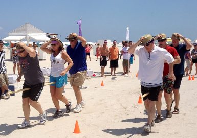Teams doing the Pole race on the beach