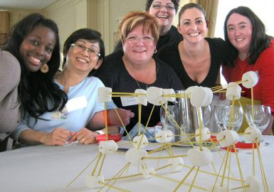 Team with their completed marshmallow tower