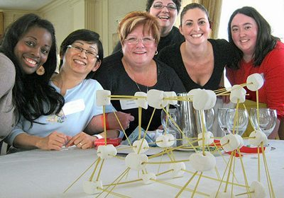 Picture of a Speed Networking team posing with finished craft