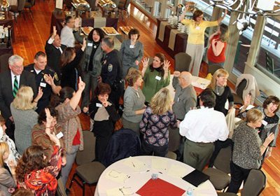 Aerial shot of Speed Networking partipants of teams doing icebreakers