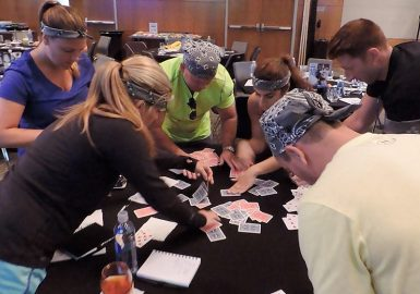 Picture of group working with playing cards during a Igniting Team Performance program