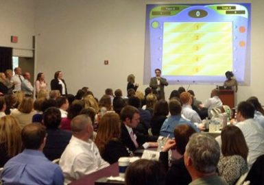 Picture of large room full of teams for our Game Show Feud program
