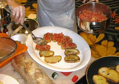 Teammate making Bruschetta