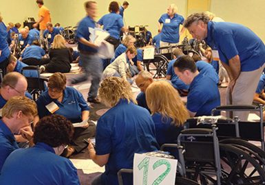 Multiple teams assembling wheelchairs
