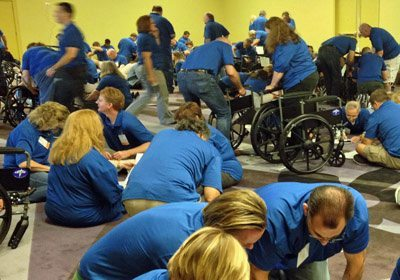 Room full of teams working on building their wheelchairs