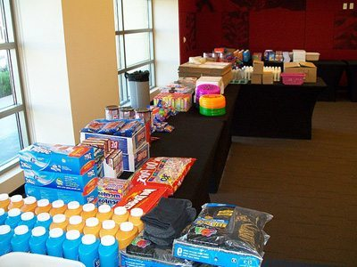 Picture of table full of supplies for the Donation Nation™ Care Packs program