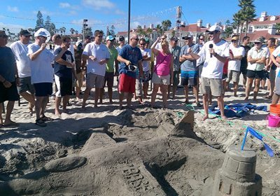 Amazing Chase SmartHunt large group crowded around sand sculpture of a jet