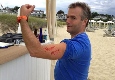 "Amazing Chase SmartHunt team member showing off temporary tattoo of ""SmartHunt"" on bicep."