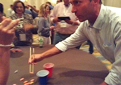 Participant doing an activity with chopsticks and candy