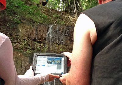 Amazing Chase SmartHunt duo interacting with iPad while searching in the forest