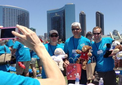 Participants taking a picture with their completed bears and blankets