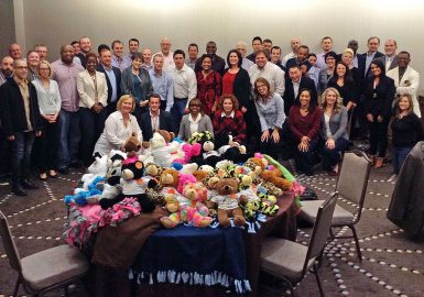 Team with Bears and Blankets Donation