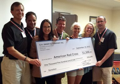 Winning team with their big check donation for the Charity Game Show