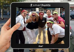 Team at Boston Marathon finish line with iPad®