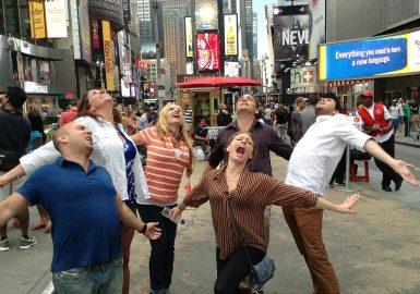 Teammates singing in Times Square, NYC