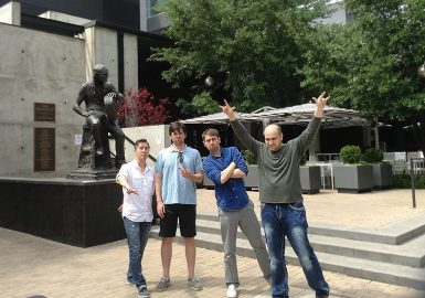 Team with Willie Nelson statue in Austin