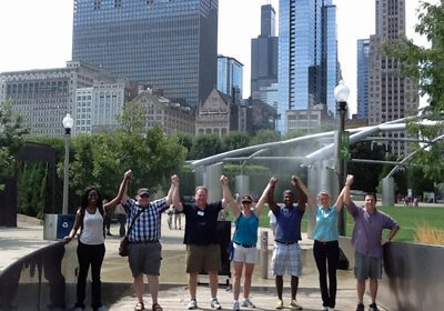 Picture of team holding hands raised above their heads during a City SmartHunt
